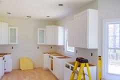 Installation of kitchen installs kitchen cabinet. Interior design construction kitchen. Installed wood kitchen cabinets with modern of installs cabinet royalty free stock photography