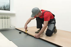 Installation of a laminate in the room Royalty Free Stock Photography