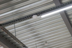 Installation of lighting fixtures suspended ceiling Royalty Free Stock Images