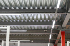 Installation of lighting fixtures suspended ceiling Stock Photo