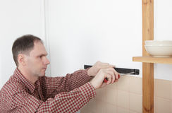 Installation of magnetic knife rack Royalty Free Stock Images