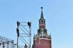 Installation of metal structures for the event on Red Square. Metal structures on the background of the Spassky Tower of the Moscow Kremlin royalty free stock photos