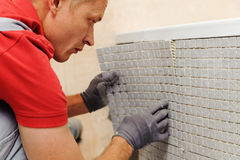Installation of mosaic tiles. Royalty Free Stock Photos