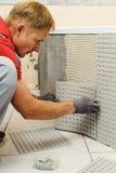 Installation of mosaic tiles. Royalty Free Stock Photos