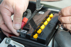 Installation of the motorbike battery. An installation of the motorbike battery Royalty Free Stock Images