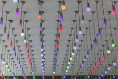 Installation of multi-colored light bulbs on the ceiling Royalty Free Stock Image