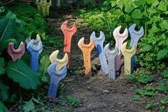 Installation of multi-colored spanners, buried in the ground stock photo