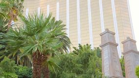 Installation near the hotel Mandalay Bay. Las Vegas, Nevada - April 2017: Installation near the hotel Mandalay Bay in the form of a tropical oasis with a bridge stock footage