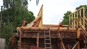 Installation of a new wooden roof on a dwelling house by a team of joiners and roofers