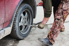 installation of passenger car wheel and replacement on spring tire. Royalty Free Stock Image