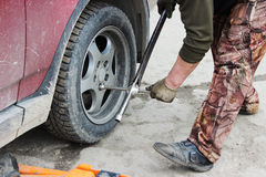 installation of passenger car wheel and replacement on spring tire. Stock Photos