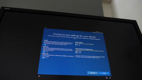 Installation process of Microsoft Windows 10 NEC Spectraview display. London, United Kingdom - Circa 2019: POV at the large NEC Spectraview 322UHD screen with stock video footage