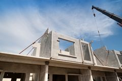 Installation process of prefabricated wall panels. Royalty Free Stock Photos