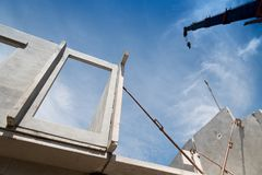 Installation process of prefabricated wall panels. Royalty Free Stock Images