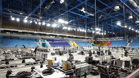 Installation of professional sound, light, video and stage equipment for a concert in a sports hall. Stock footage