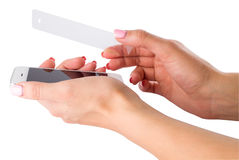 Installation of protective glass on the smartphone Stock Images