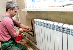 Installation of a radiator Royalty Free Stock Photos