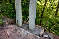 Installation of reinforced concrete poles stock photos