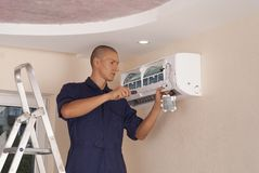 Installation and repair of air conditioner stock photos