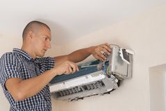 Installation and repair of air conditioner royalty free stock images