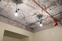 Installation and repair of electric cable, lamp bulb, smoke detector, fire alarm system before installing stretch or suspended. Installation and repair of royalty free stock photography
