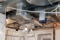 Installation and repair of frame, ventilation system, electric cable, lamp bulb before assembling stretch or suspended ceiling. Concept of reconstruction in an stock photos