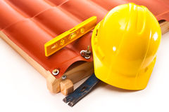 Installation and repair of roofs. Roof made of polycarbonate, a working safety helmet and a water level on a white background Stock Photo