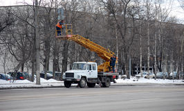 Installation of a road sign on a column on Volokolamskoye Highway. Roadwork. Moscow royalty free stock photos