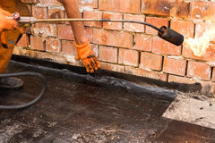Installation of roll waterproofing royalty free stock photos