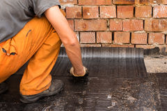 Installation of roll waterproofing stock images