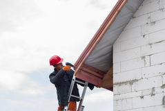 Installation of a roof stock photos