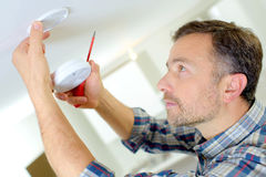 Installation smoke alarm. Installation of a smoke alarm Stock Images