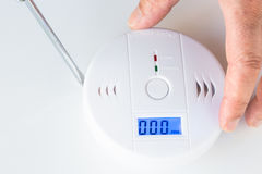 Installation of a smoke and fire alarm with carbon monoxide sens stock photography