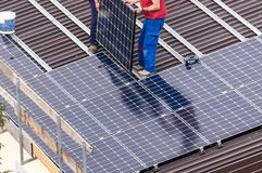Solar panel and workers. stock photo
