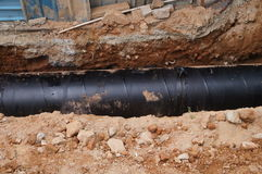Installation souterraine de tuyau Image libre de droits