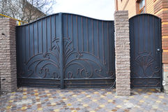 Installation of Stone and Metal Fence with Door and Gate. For Car Royalty Free Stock Photos