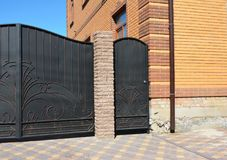 Installation of Stone and Metal Fence with Door and Gate. royalty free stock photos