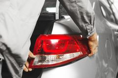 Installation a tail light on car, close-up. Vehicle repair after an accident royalty free stock images