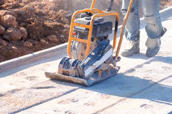 Installation for tamping asphalt. Photo machine in action Stock Photos