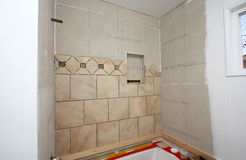 Installation of tiles in bath Stock Images