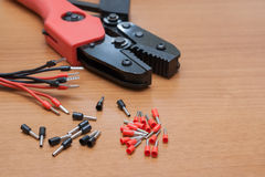 Installation Tool (crimp) terminals for the cable. Ratcheted Crimping Tool. Stock Photos