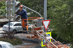 Installation of a traffic light on a lift. Stock Photography