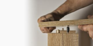 Installation using a threaded furniture fastener tool. Screwing with a tool threaded furniture fastener stock images