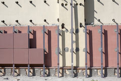 Installation of ventilated facades with tiles. Building wall Stock Images