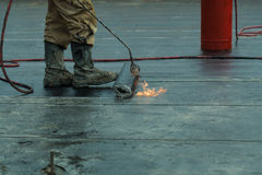 Installation  waterproofing propane blowtorch dur Stock Photography