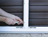 Installation of white plastic window Stock Image