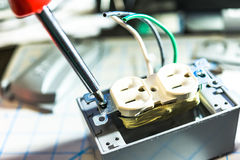 Installation wire in to a plug. Royalty Free Stock Images