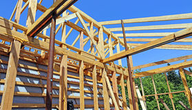 Installation of wooden beams at construction Royalty Free Stock Photo