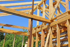Installation of wooden beams at construction Royalty Free Stock Image