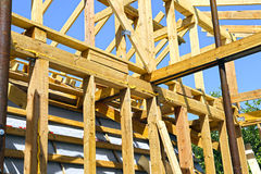 Installation of wooden beams at construction of frame house Royalty Free Stock Image